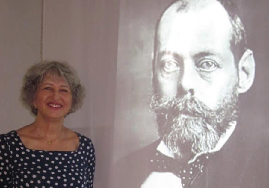 Ruth Schreiber stands beside her exhibit of the Balfour Declaration