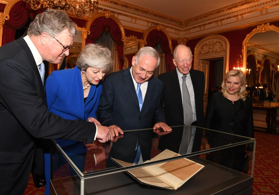 Benjamin Netanyahu and British Prime Minister Theresa May look at the original Balfour Declaration