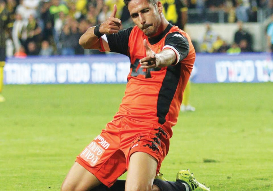 B'nei Yehuda forward Almog Buzaglo celebrates his first of two goals in a match against Beitar Jerus