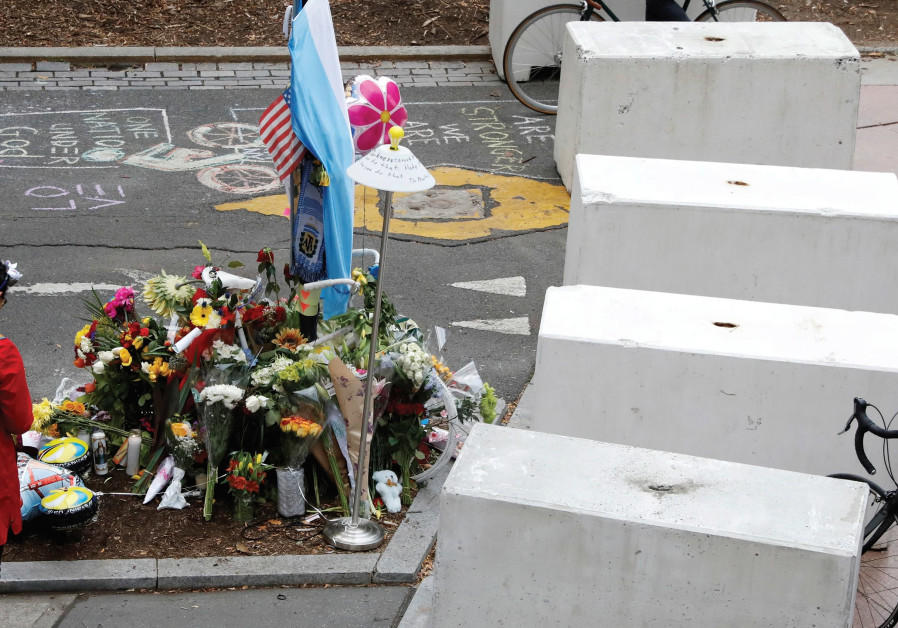 PROTECTIVE BARRIERS are placed along a bike path near a memorial to remember the victims of the New