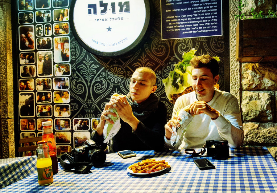 Famous South African photographers Alexi Portokallis and Miklas Manneke eat falafel