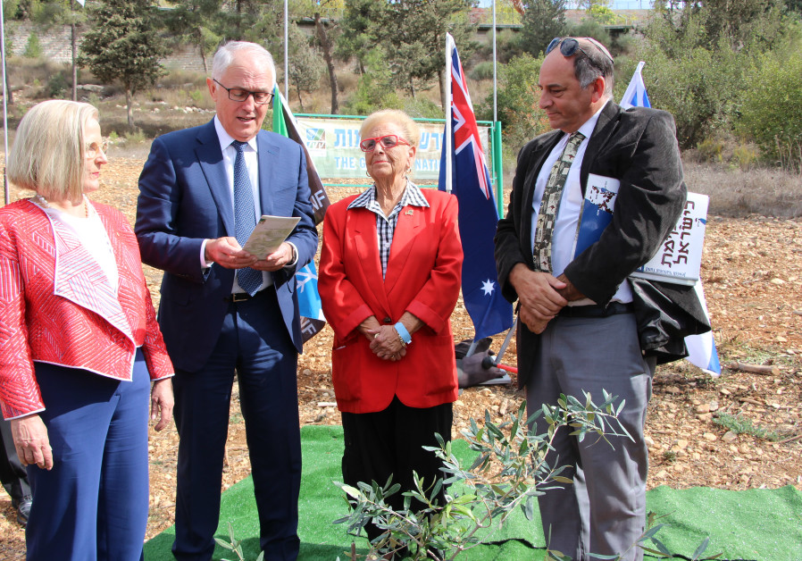 Australian Prime Minister Malcolm Turnbull plants an olive tree in Jerusalem's Grove of Nations