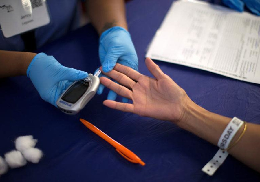 A person recieves a test for diabetes, illustrative