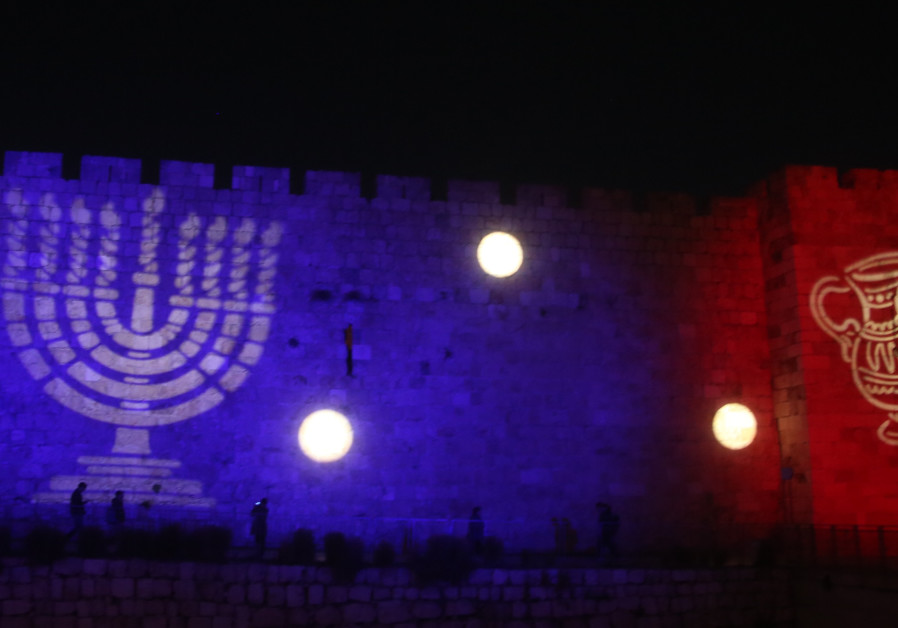Hanukkah images are displayed on the walls of the Old City in Jerusalem
