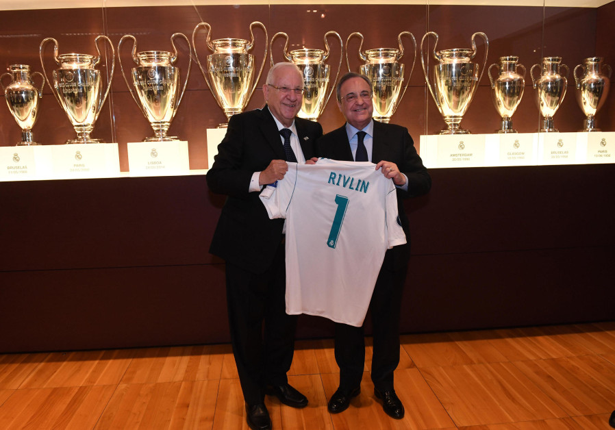 President Reuven Rivlin receives Real Madrid shirt from Florentino Perez, President of Real Madrid.