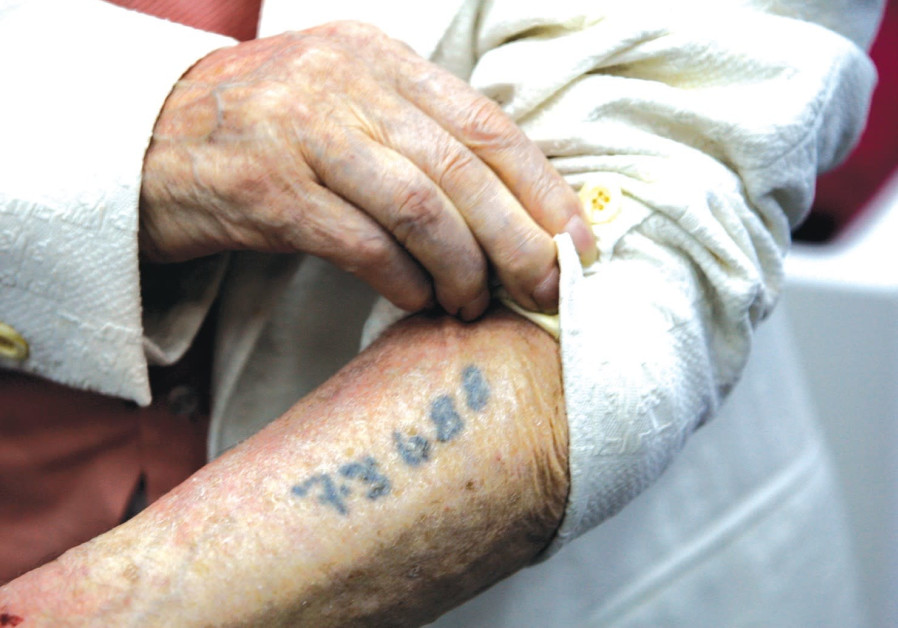 A Holocaust survivor shows his tattoo