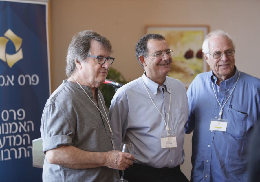 ARIE DUBSON (center), A.M.N Foundation general manager, poses with two of this year's EMET Prize win