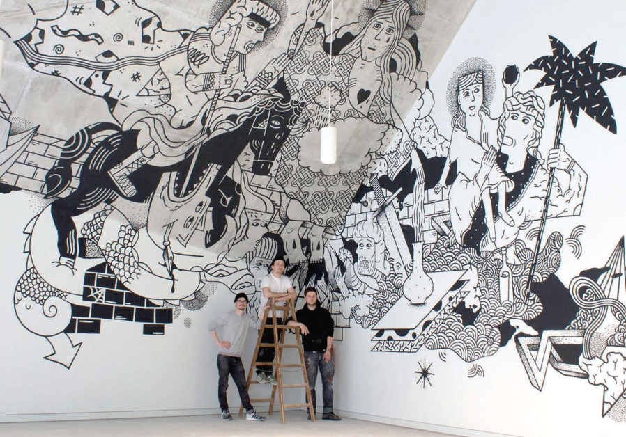 Three of the Klub7 artists are dwarfed by one of their large-scale murals.