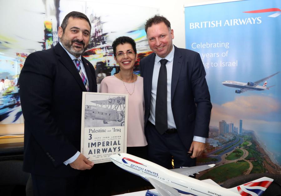 """British Airways CEO Alex Cruz (left) hoists an advertisement hailing Mandatory """"Palestine to Iraq"""""""