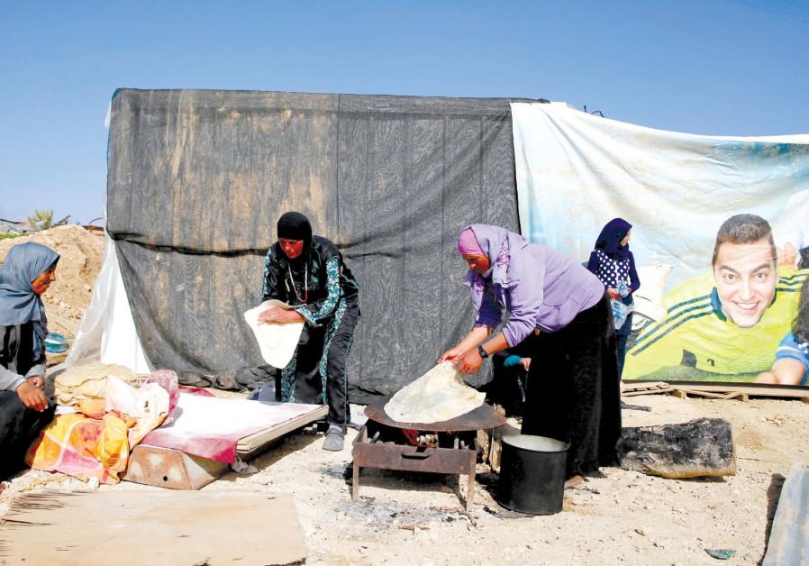 Women prepare traditional flat bread in the Beduin village of Umm al-Hiran, northeast of Beersheba.