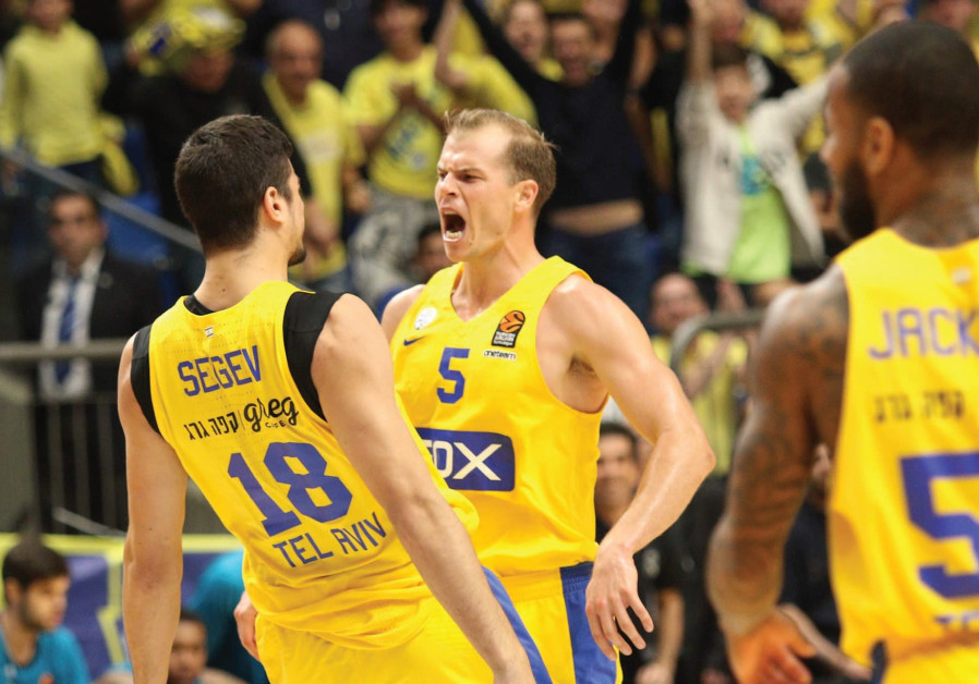 Maccabi Tel Aviv forward Michael Roll (5) celebrates with teammate Itay Segev during a 90-83 win ove