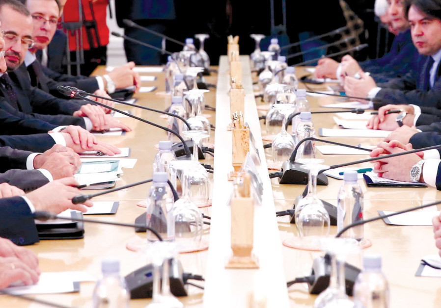 THE FOREIGN MINISTERS of Russia, Turkey and Iran and members of their delegations attend a meeting i