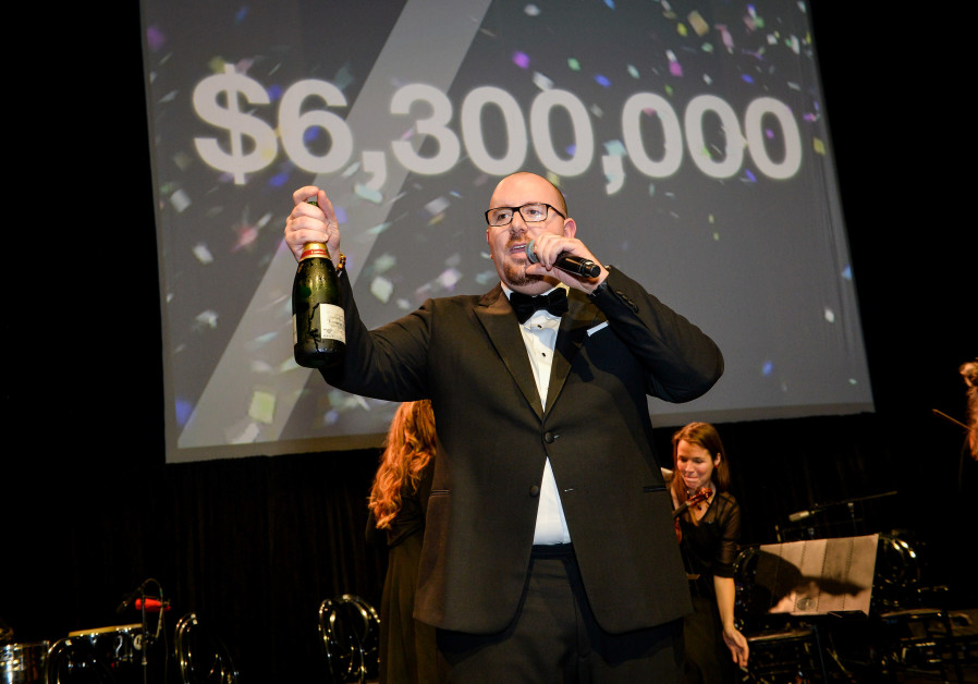 NF Montreal President Michael Goodman celebrates reaching an ambitious fundraising goal