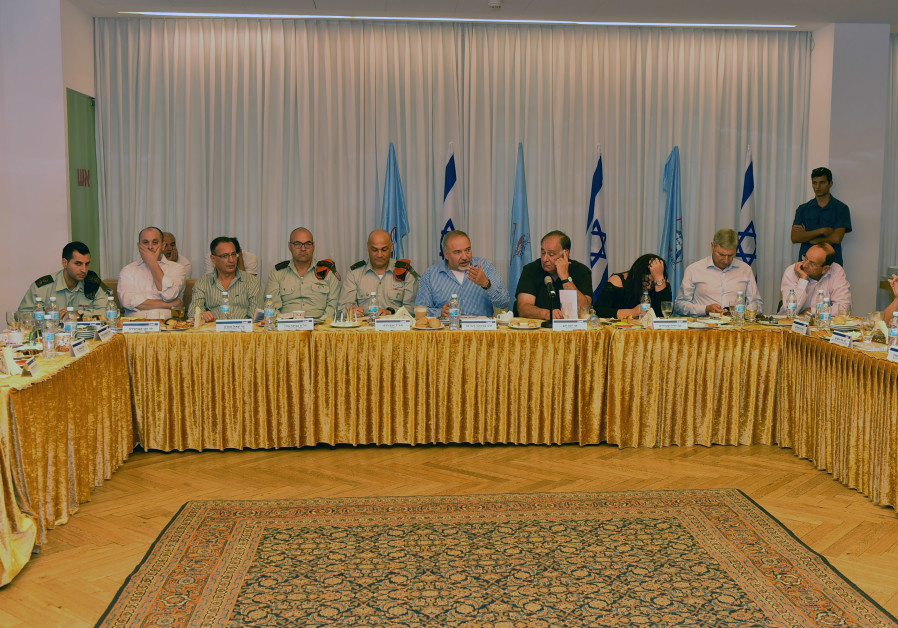 Defense Minister Avigdor Liberman addresses a meeting of local officials in Haifa.