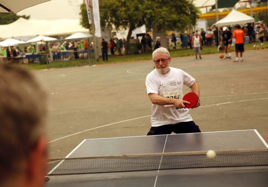 Senior Israelis play table tennis as they take part in games for people over 65 years old, organized