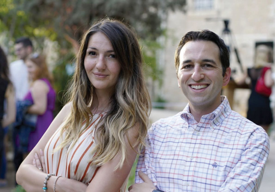 ROI COMMUNITY members Ivona Gacevic and Eric Gershman pose at the organization's summit in July