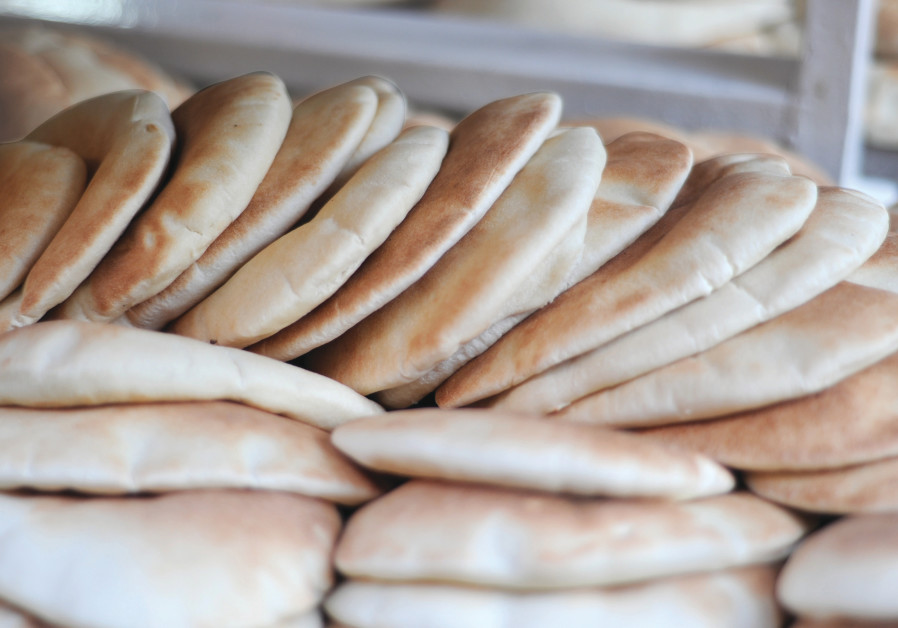 The frst secret of pita/lafa baking is a very hot  oven and a very short bake