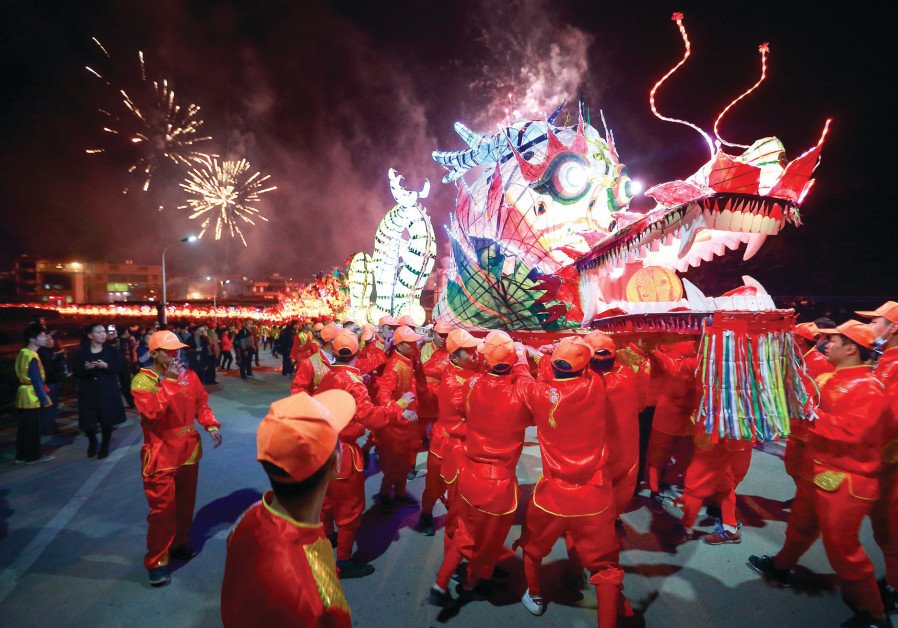 PEOPLE PERFORM with a long dragon lantern as they celebrate the Chinese New Year, in Longyan, Fujian