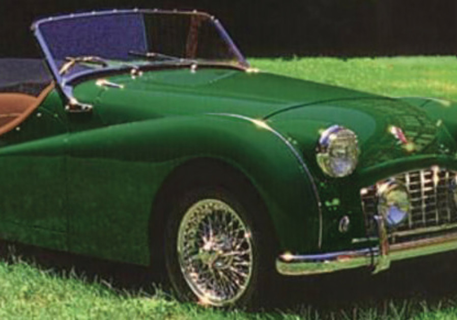 THE LONGED-FOR Triumph TR3, in British Racing Green
