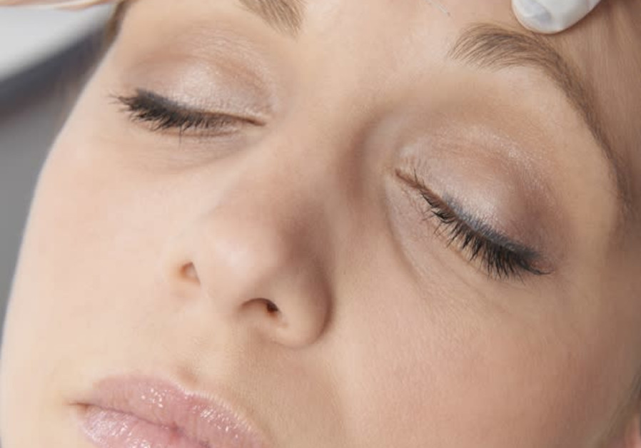 A woman receiving a Botox injection