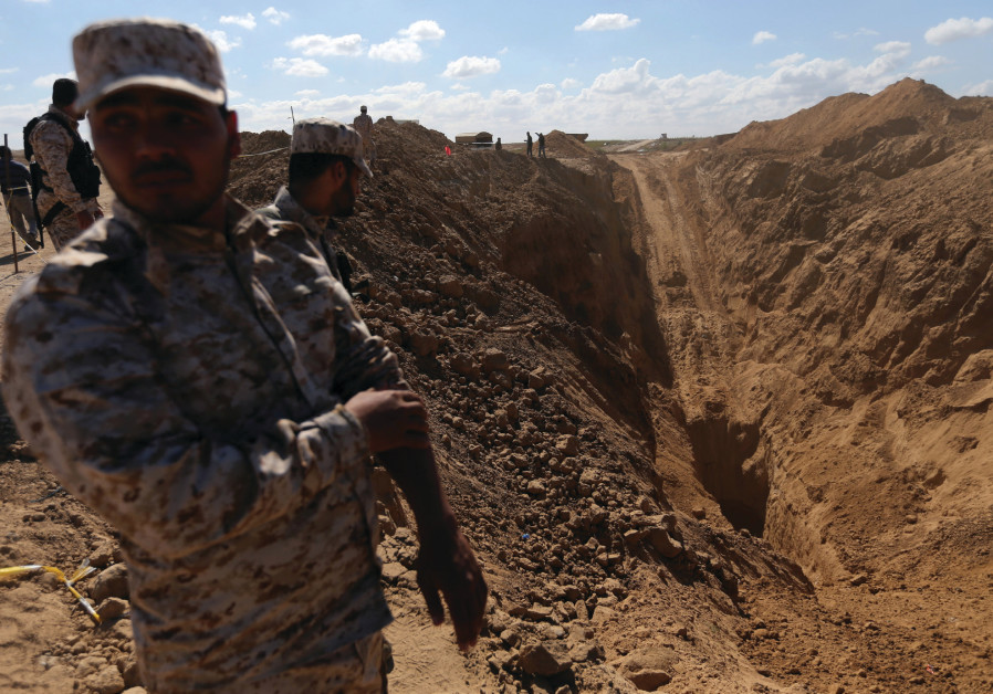 Hamas security forces stand near the entrance to the cross-border tunnel in Khan Yunis, in the sout