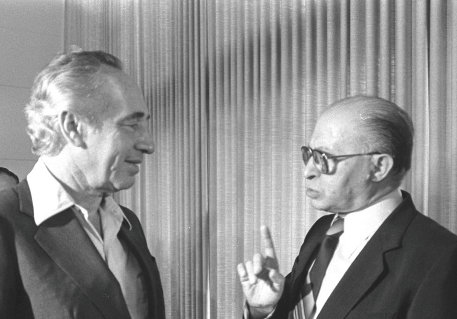 Shimon Peres and Menachem Begin chat at the inaugural session of the 10th Knesset in 1981