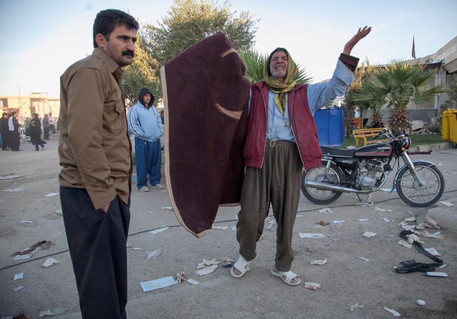 A man reacts following an earthquake in Sarpol-e Zahab county in Kermanshah, Iran