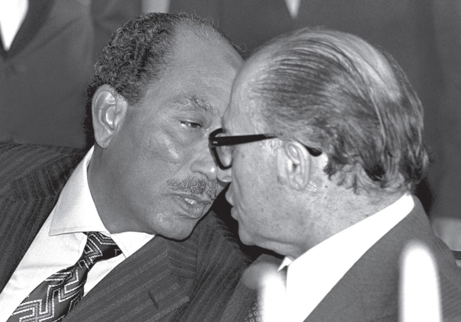 ANWAR SADAT and Menachem Begin chat during the former Egyptian president's historic visit to Jerusal