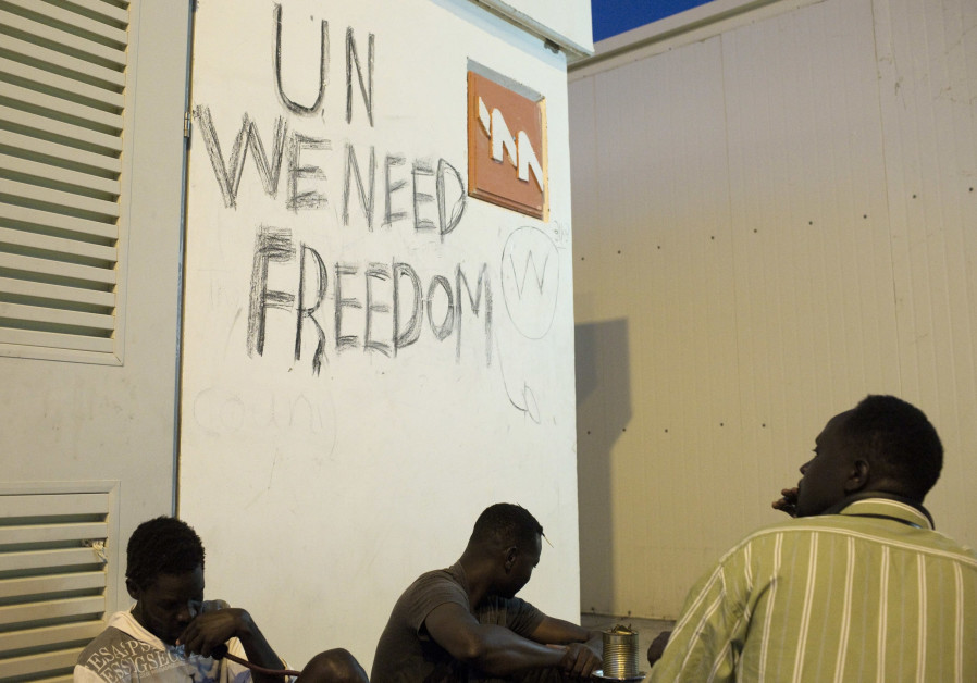 African migrants sit at the Holot open detention center in the Negev in Southern Israe