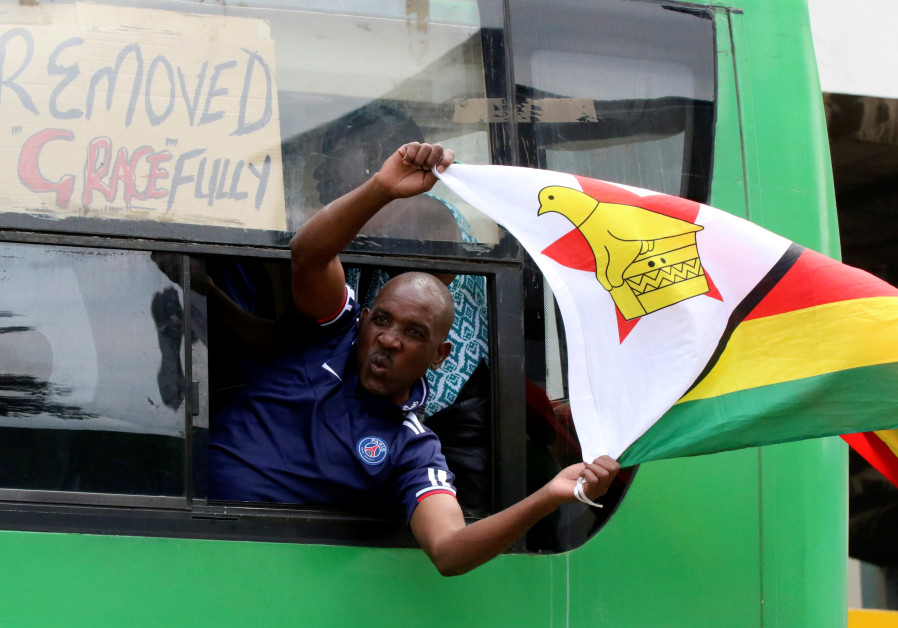 A man calling for Zimbabwean President Robert Mugabe to step down protests in Harare, Zimbabwe