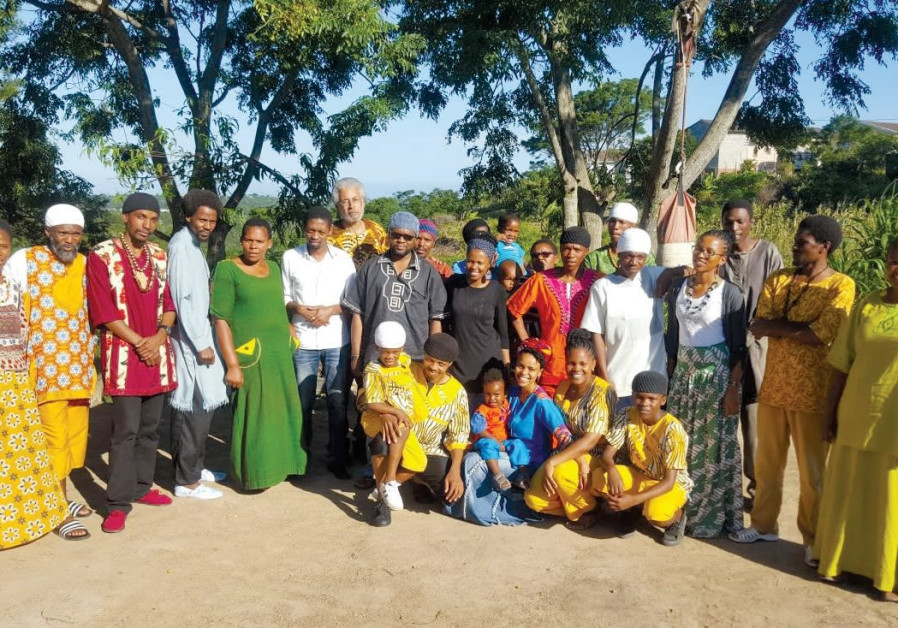 MEMBERS OF the AHI community in East London, South Africa, with Dimona community leader, Minister Ah