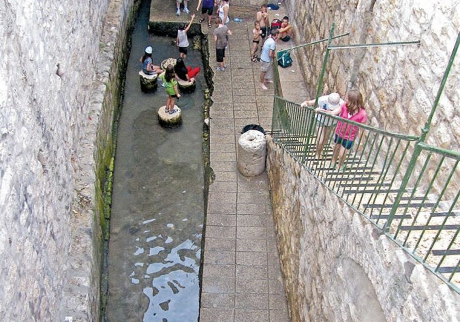TOURISTS VISIT Jerusalem's ancient Shiloah (Siloam) pool, the place where pilgrims would immerse bef