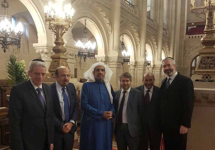 Rabbi Moshe Sebbag of the Great Synagogue of Paris (far right) and France's Chief Rabbi Haim Korzia (second from right), host Secretary General of the Muslim World League Dr. Muhammad Abdul-Kareem al-Issa (third from left) and Khalid bin Mohammed Al Angari, the Saudi ambassador to France (second)