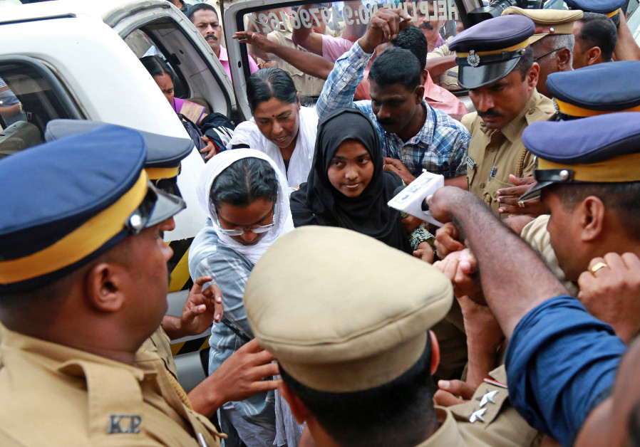 Akhila, 24, who converted to Islam in 2016 and took a new name, Hadiya, arrives in Kochi, India