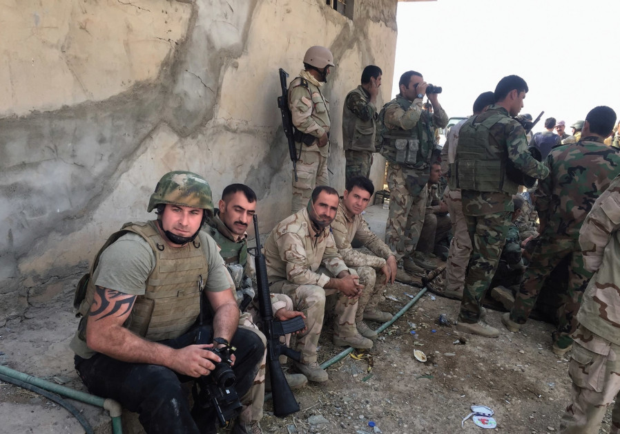 THE AUTHOR with Kurdish Peshmerga during the offensive near Bashiqa in October 2016.