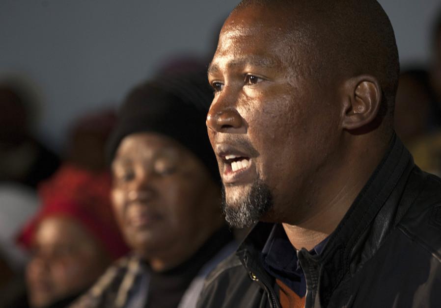 Mandla Mandela, grandson of Nelson Mandela, speaks to reporters in South Africa