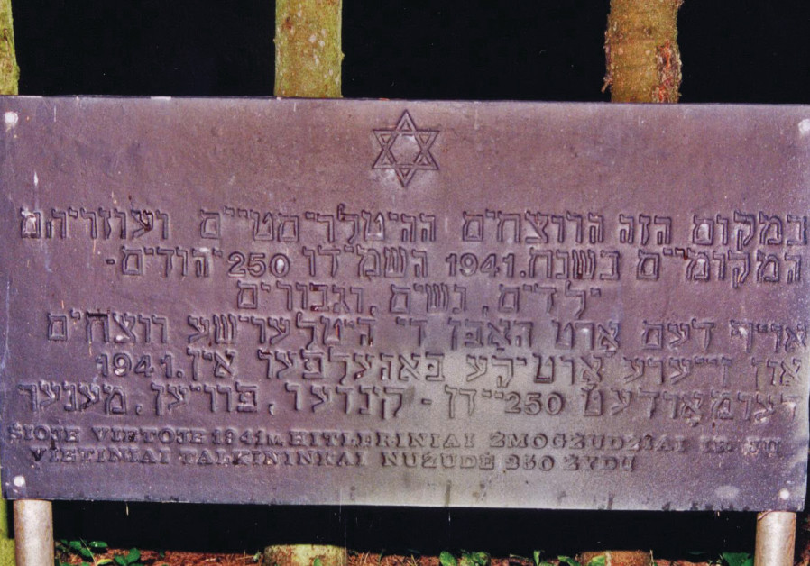 A sign in Yiddish, Hebrew and Lithuanian saying,'In this place the Hitlerist murderers and their loc