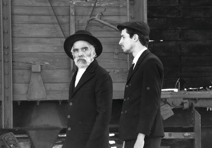 A still from the movie '1945' showing the two Jewish protagonists at a railway station in rural Hung