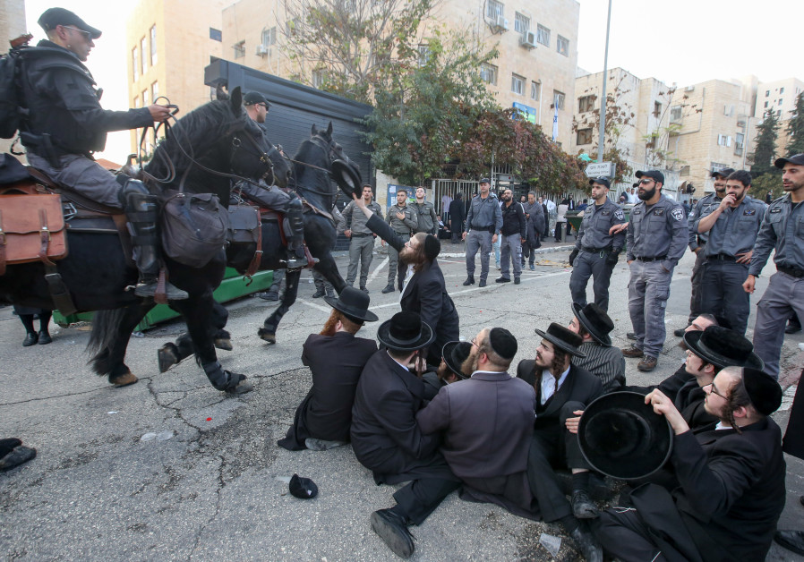 Haredi men protest outside the draft office in Jerusalem on November 28.