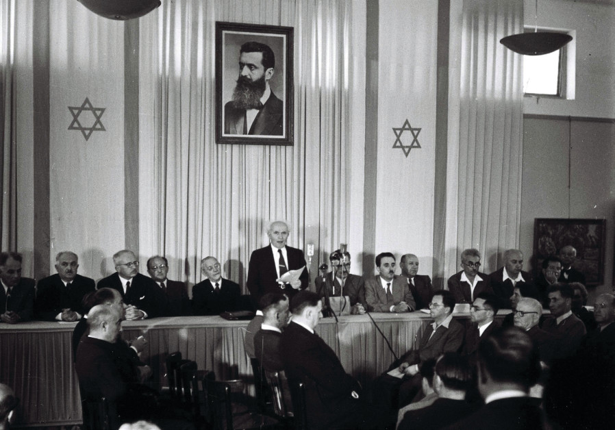 DAVID BEN-GURION reads the declaration of Israel's independence in Tel Aviv in 1948.