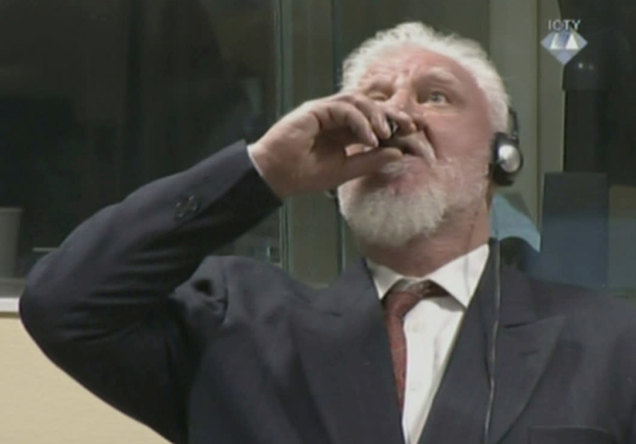 Bosnian Croat general dies after drinking poison in courtroom
