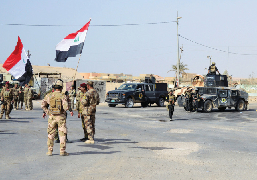 IRAQI FORCES are seen last month after they captured Rawa, the last remaining Iraqi town under Islam