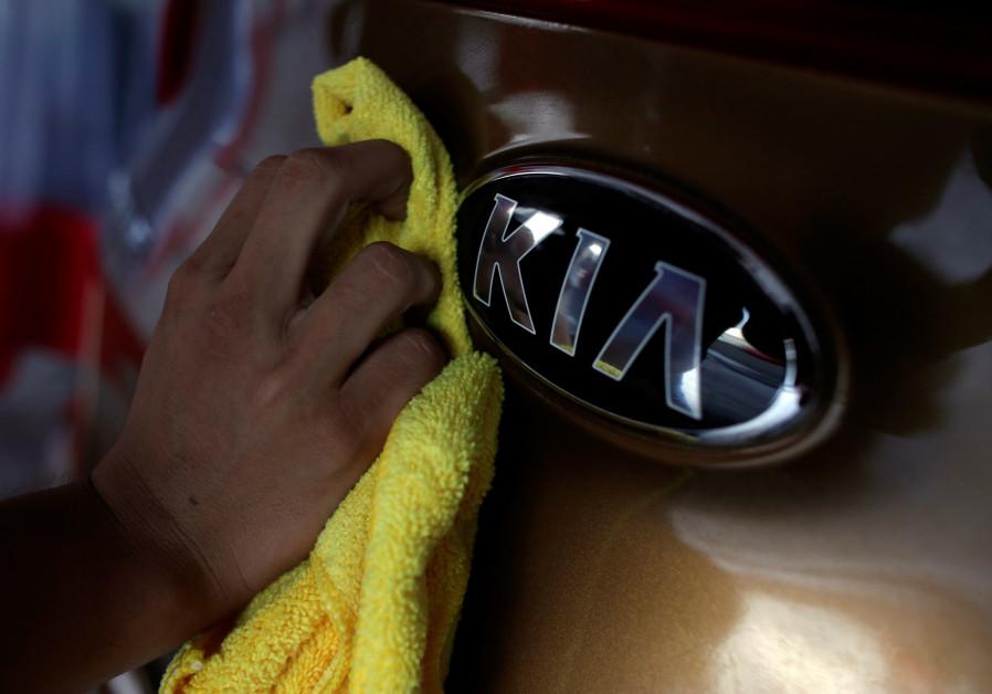 The logo of KIA Motor at car dealership