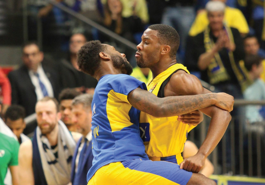 Maccabi Tel Aviv guard Norris Cole (right) celebrates with DeAndre Kane, with the former scoring a s