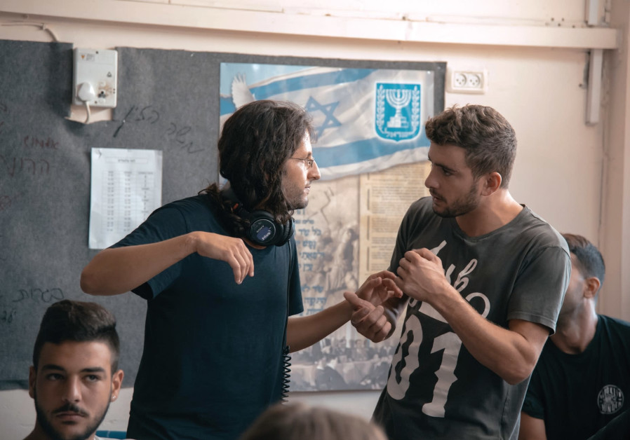 MATAN YAIR (second from left) directs a scene from his debut film 'Scaffolding.'