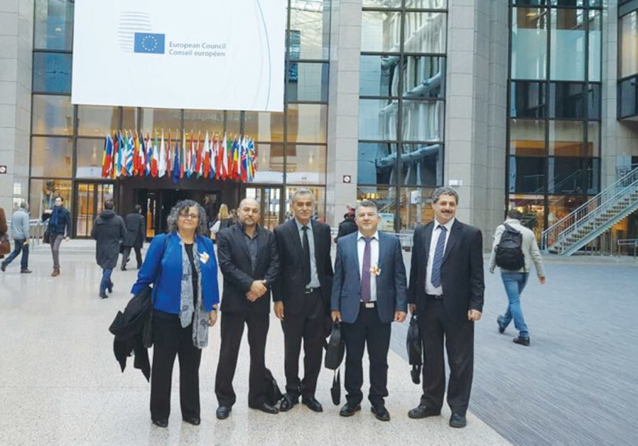 JOINT LIST members of Knesset stand in front of the European Council in Brussels last month.