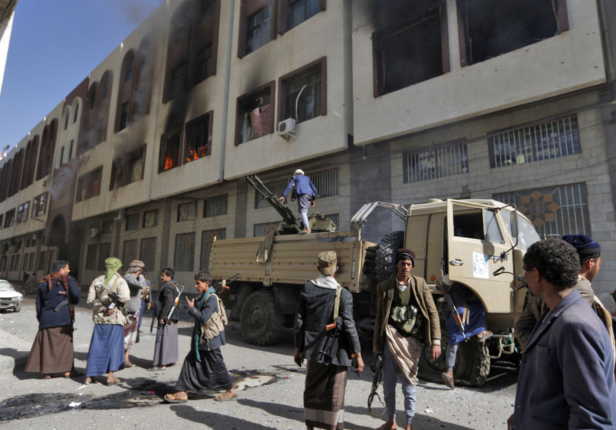Houthi rebel righters in front of the residence of Yemen's former President Ali Abdullah Saleh