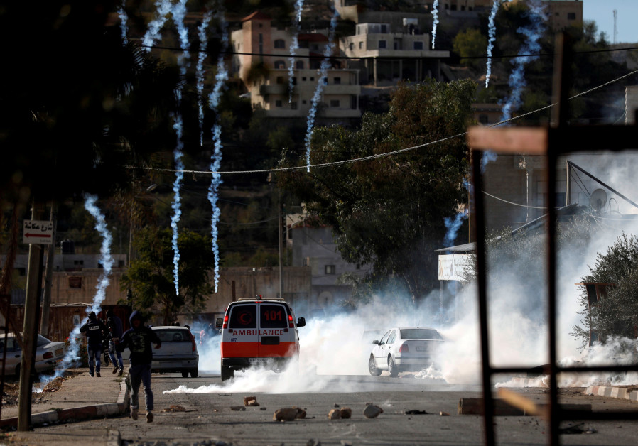 Palestinians clash with Israeli troops in the West Bank village of Kusra