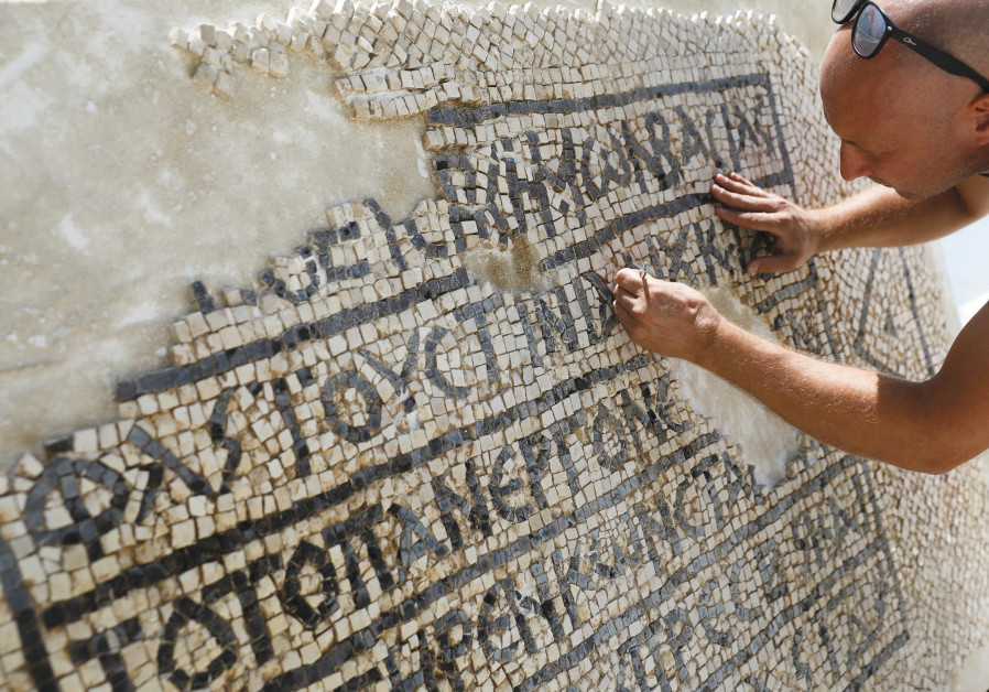 A CONSERVATIONIST works at the Rockefeller Museum in Jerusalem on a 1,500-year-old mosaic floor.