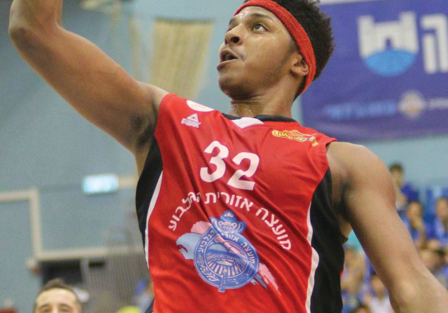 Hapoel Gilboa/Galil forward Zach LeDay scores two of his game-high 25 points in last night's 99-74 w